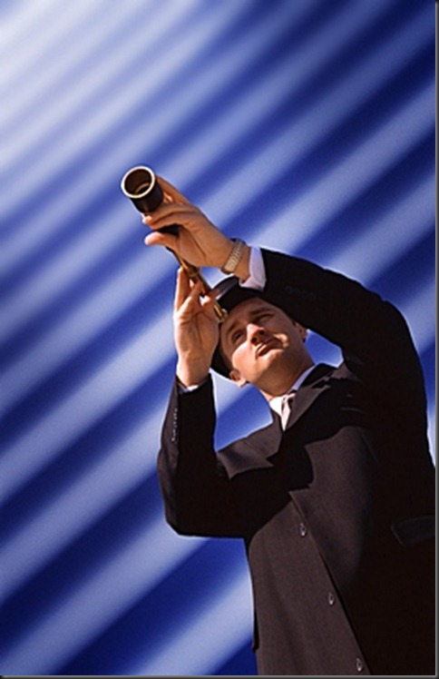 man_on_ripples_with_telescope