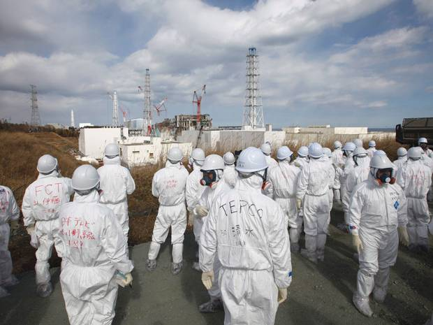 Members of the media wear protective suits asthey are shown around by Tepco staff, 21 February 2012. EPA via independent.co.uk