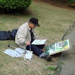 man painting at Shinjuku Gyoen in Shinjuku, Tokyo, Japan