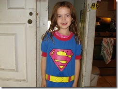 Naomi Rivka, 7, Toronto, Canada - normally more of a princess, posing in her brother's Superman shirt for Sam!!!