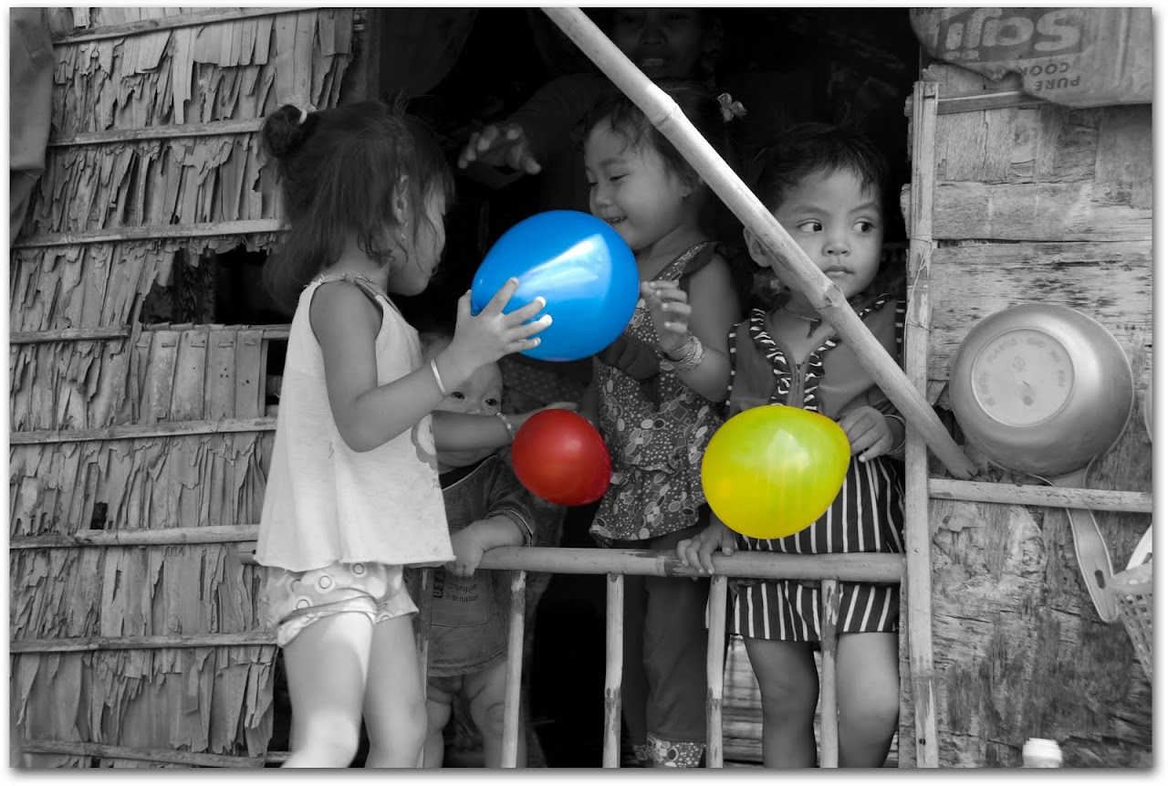 Kids with balloons in Cambodia