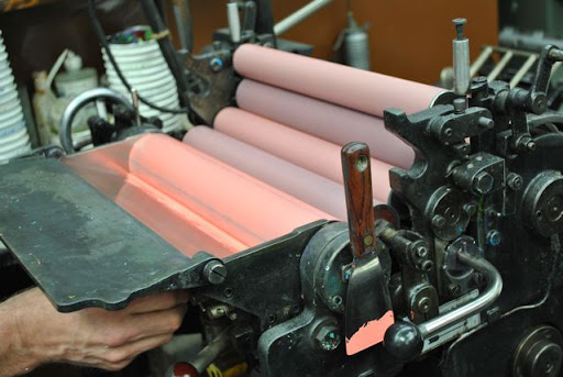 Here the ink is being rolled through -- I love all of the pinks in this shot!