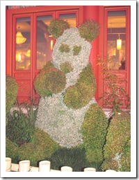 Florida vacation Epcot topiary panda bear in front of China