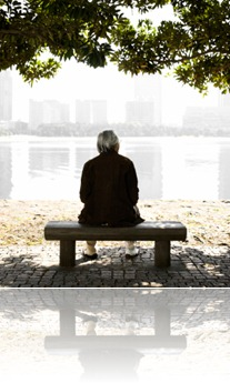 Senior Man Sitting on a Park Bench