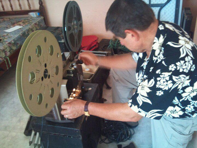 Missionary Ken Priebe from Power to Change inspects the Jesus Film equipment.