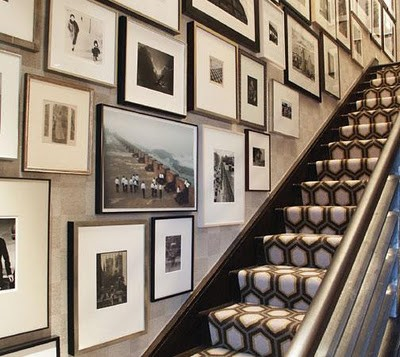 I love this gallery wall on the stairwayit is a good use of the space and it is nice that all of the images are black and white.  http://pinterest.com/pin/50243352062552314/