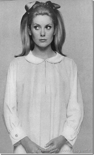 Catherine Deneuve is wearing a white crepe nightshirt with little round collar and cuffs by Sylvia Pedlar of Iris, photo by husband David Bailey for Vogue 1966