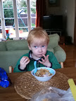 Lachie enjoying his breakfast...