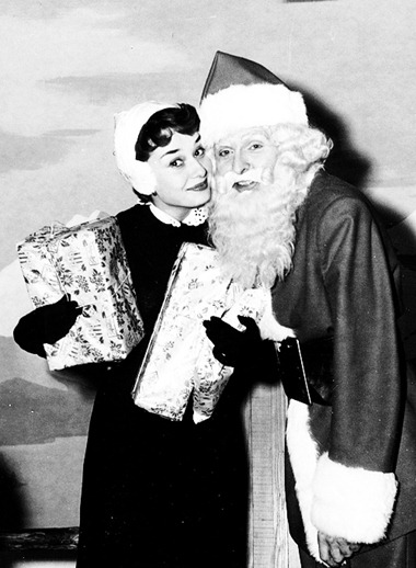 Audrey Hepburn and Santa 1955