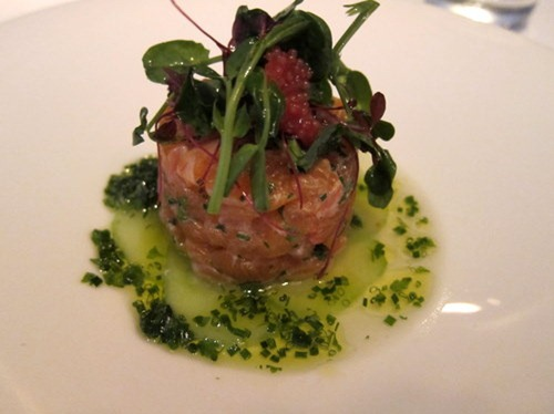 Sea trout tartare with pickled cucumber, tomato consommé and tobikko