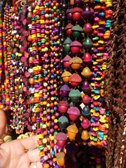 Colourful necklaces made from corn, nuts, and peas.