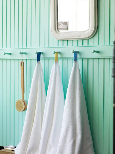 A Shaker peg rail is also good for holding multiple towels in a bathroom.