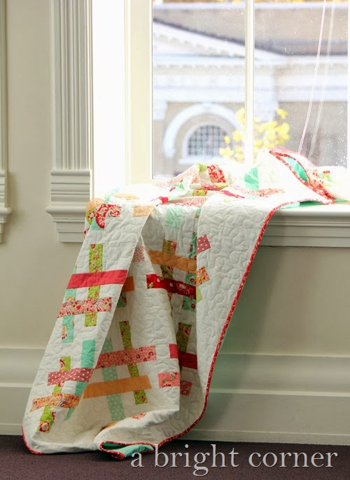 Quartet quilt pattern by Andy of A Bright Corner - a jelly roll quilt pattern with four sizes.  Perfect for using pre-cut strips.