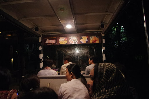 A tram leads visitors through the Singapore Zoo's Night Safari.