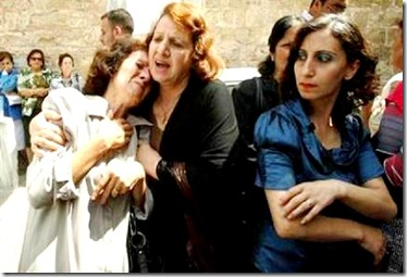Palestinian Christian protesters lament forced conversions of loved ones.