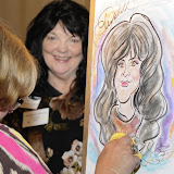 Not quite artists along the Seine, but pretty close, as caricaturists captured every alumna for a complimentary portrait.