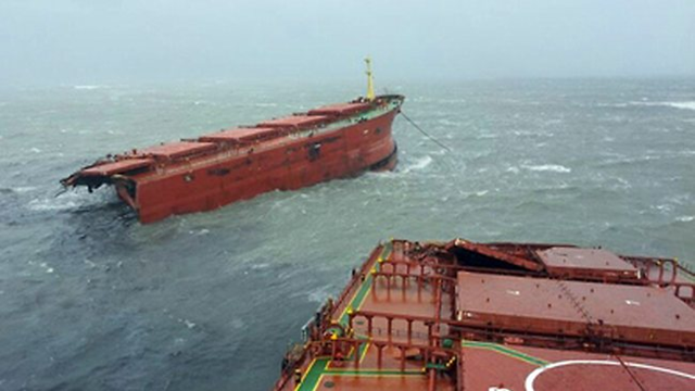 A 77,000-tonne bulk carrier broken in two is seen in the aftermath of typhoon Bolaven off the port of Sacheon, about 300 kms southeast of Seoul, 28 August 2012. AFP