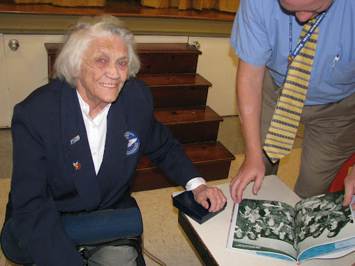 Young presents a book on the Women Airforce Service Pilots, or WASP, to the Boyd Elementary School principal.