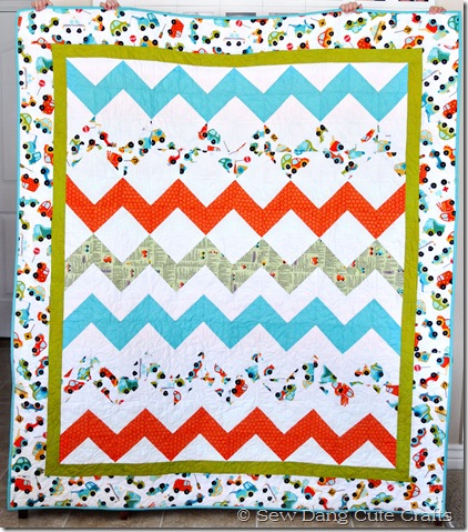 Girls-holding-finished-quilt