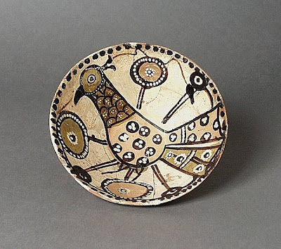 Bowl Iran Bowl, 11th century Ceramic; Vessel, Earthenware, underglaze slip-painted, 2 1/2 x 6 7/8 in. (6.35 x 17.46 cm) The Nasli M. Heeramaneck Collection, gift of Joan Palevsky (M.73.5.144) Art of the Middle East: Islamic Department.