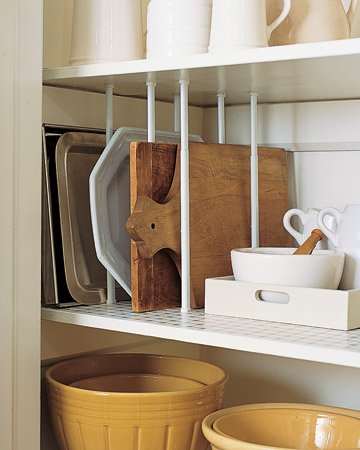 Just like the pots' and pans' lids, this is a great way to organize cutting boards and platters. Why stack platters and have to dig through them when you need them right away -- instead keep them stacked on their sides.