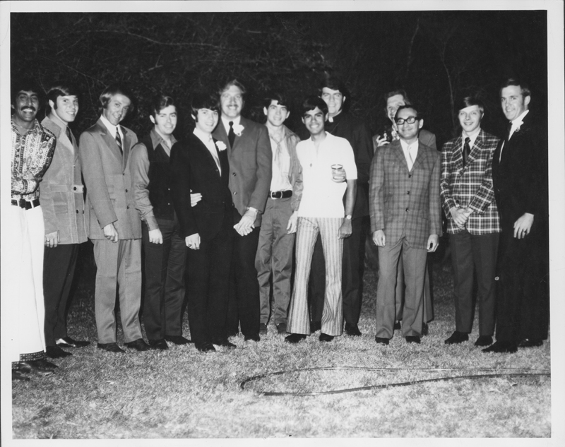 Friends gather for pictures after the marriage ceremony of Jack Wilson and Ron Douglas. The picture includes Frank Magill, pseudonym Paul Bach (neckerchief), Steve Jordon (striped pants), and Reverend Troy Perry (clergy collar). 1970.