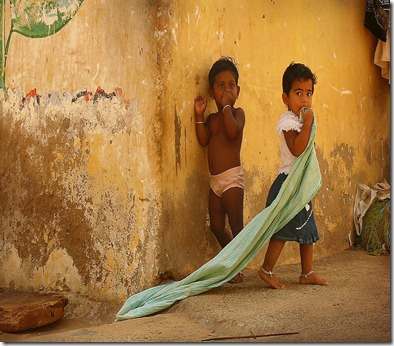 -indian-children-near-yellow-wall-in-the-village-of-kanyakumari-anastasiia-kononenko