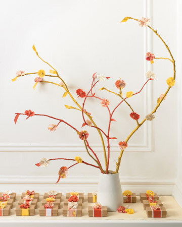Create a lasting bouquet she can display anytime. A bunch of branches wrapped in seam binding and bedecked with fabric flowers makes a striking alternative to a traditional floral arrangement. (marthastewart.com)