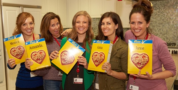 Bloggers at General Mills HQ with cheerios box