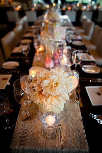 Just a reminder that candles glow in orange! Hints of a twinkling lights tucked in a centerpiece will add mysterious allure to your Halloween decorations. (www.stylemepretty.com)