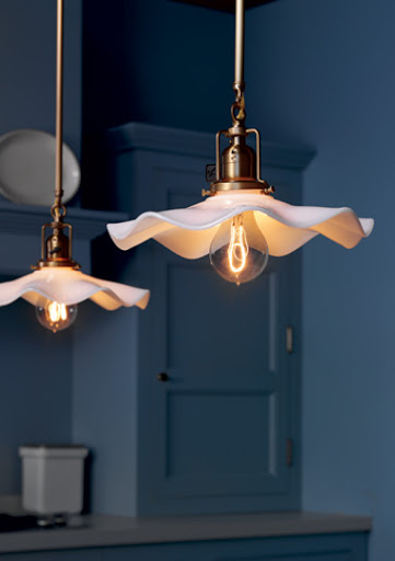 Rejuvenation's scalloped shade with George Industrial Pendant.  In order to get this shape, the shade is first shaped as a dome, then pressed flat and then scalloped.