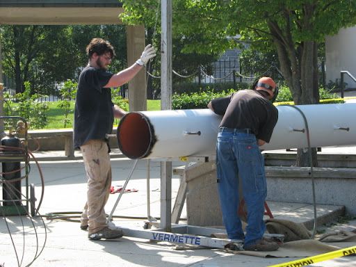 A cleanup crew disassembles and removes the fallen light. (photo credit: Sam Senovich)