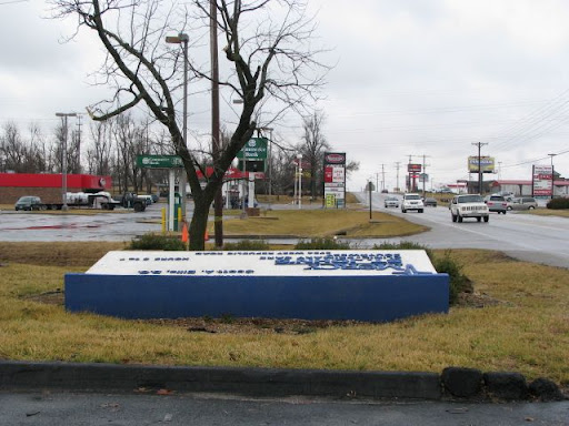 A large sign is damaged along Republic Road.