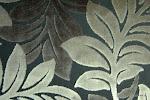Tkanina obiciowa, trudnopalna. Pluszowa. Motyw roślinny - liście. Szara, czarna.