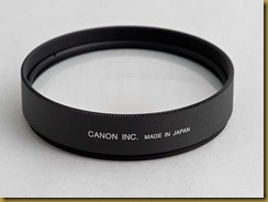 250d close up lens screws onto the front element of a standard lens