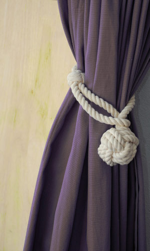 Hold curtains in their place with this unique monkey-fist knot rope tieback. (stairropes.com)