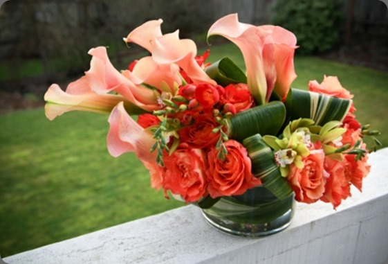IMG_5581 Orange Finesse roses, Motzart Callas, red freesia, green mini cymbidium orchids and aspidistra leaf studio 3 floral design blogspot