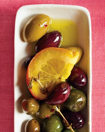 Marinated Olives: Jazz up purchased olives with citrus slices and fresh herbs for an easy New Year's appetizer.