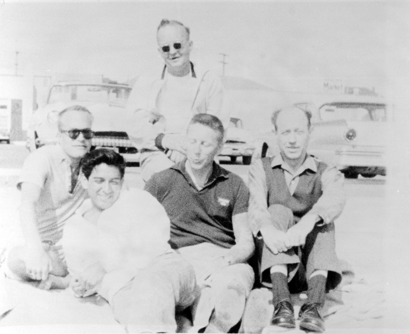 Dale Jennings [?], Tony Reyes, Chuck Rowland, and W. Dorr Legg, ( left to right, front) and one other from the early days of ONE Incorporated. Circa 1950s.