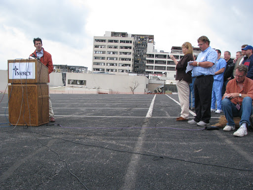 Mercy Health System's CEO Lynn Britton during the press conference at St. John's Regional Health Center in Joplin (seen in background).  (Photo credit: Jennifer Moore)