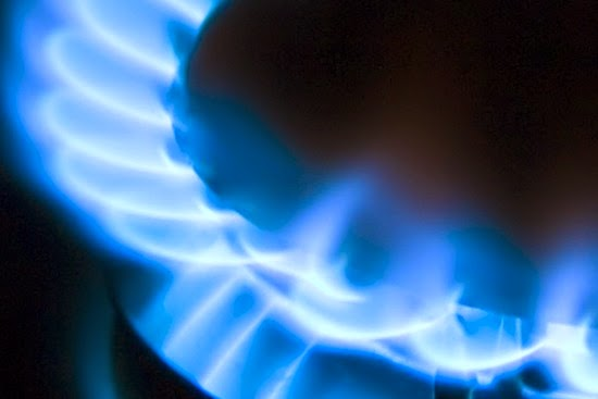 image of blue gas flame burning on gas cooker