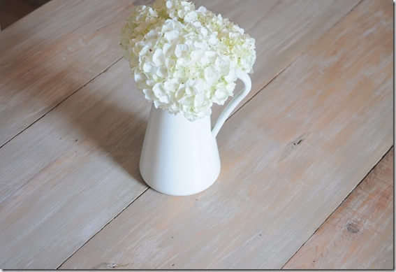 plank table with flowers