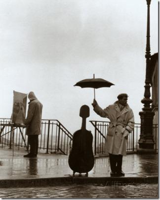 robert-doisneau-musico-bajo-la-lluvia