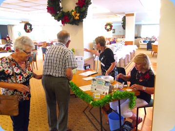 Our Events Manager, Diane Lyons (standing), and member, Margaret Black, managing the entry table and issuing raffle tickets.
