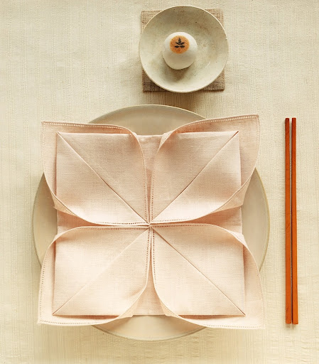Instead of a bright red napkin for the Lotus fold, a subtle color is less bold and elegant.