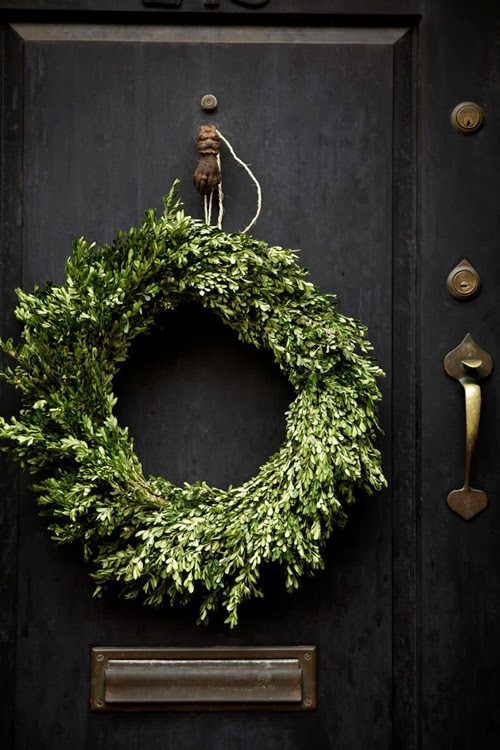 simple Christmas wreath on black door