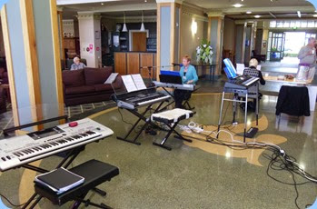 Some of the keyboards set-up in the atrium with the main lounge to the left and the dining area to the right.