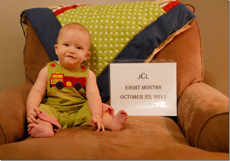 Justin 7 month with sign