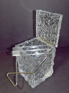 Ice block ice bucket with tongs open