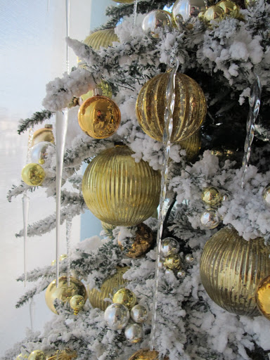I only used yellow and gold ball ornaments, and the glass icicles that I buy every year, wherever I can find them.